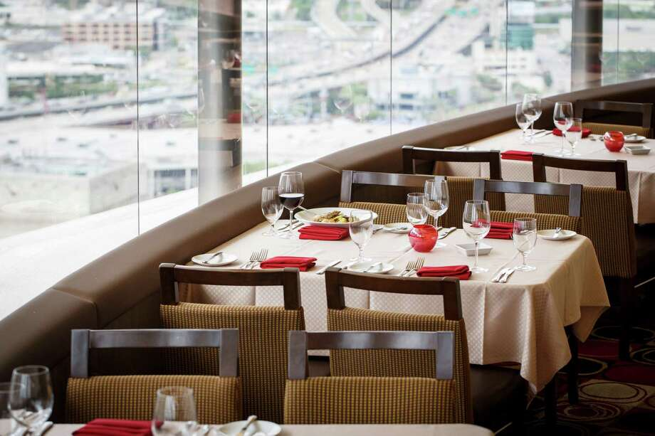 The rotating view seen at the Spindletop Restaurant at the top of the Hyatt Regency, Tuesday, May 28, 2013, in Houston.  The Spindletop is turning 40 in June and to mark the anniversary the restaurant is creating dishes and cocktails that pay homage to the food and drink of the 70's when the restaurant first made the scene.  ( Michael Paulsen / Houston Chronicle ) Photo: Michael Paulsen, Staff / © 2013 Houston Chronicle