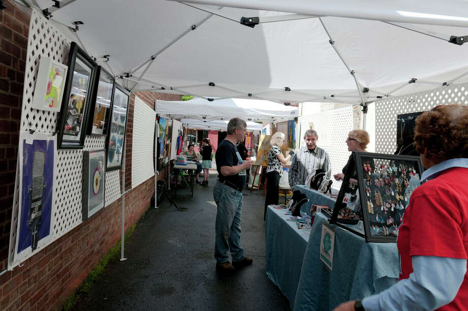 "Vendors and visitors gather at a previous Art in the Alley event hosted by the Stratford (Conn.) Arts Guild. On Sunday, Aug. 25, 2013, the guild will present its biggest art show to date with ""Artists and Artisans in Paradise,"" which will be at Paradise Green in Stratford, Conn. For more information, visit http://stratfordartsguild.net. Photo: Contributed Photo"