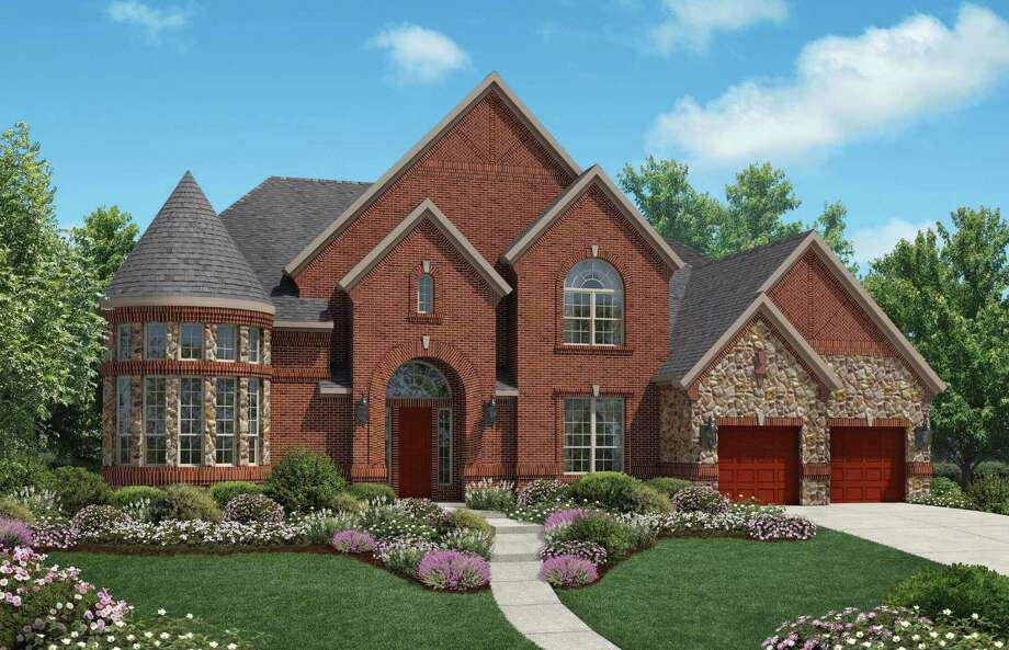 In Cinco Ranch, the grand opening of the gated Ironwood Estates neighborhood debuts new decorated model homes priced from the $600,000s by Partners In Building and Toll Brothers (shown). Forty-nine homes on 90-foot-wide homesites will be built in this new neighborhood.
