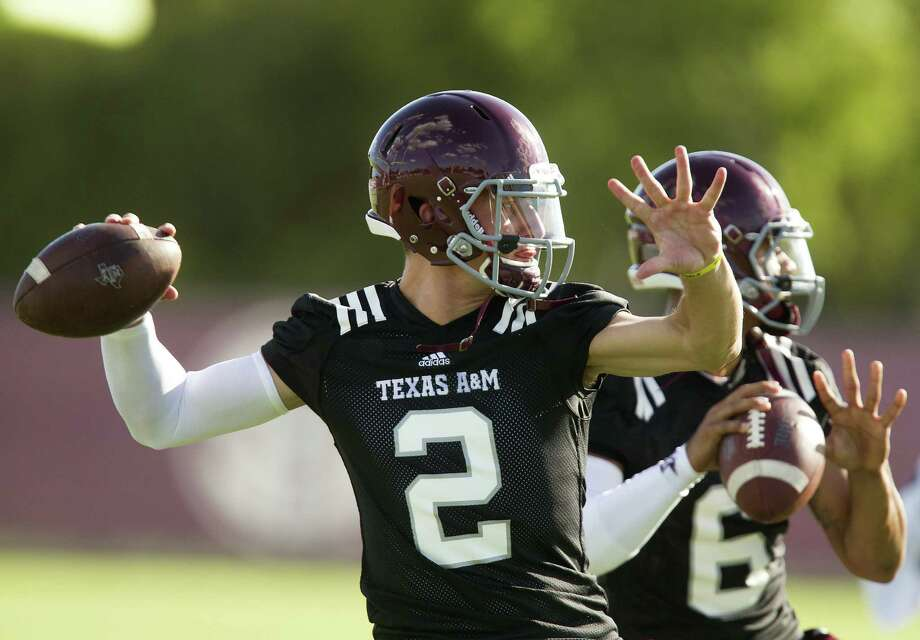 Many readers are growing weary of t stories on Texas A&M quarterback and Heisman Trophy winner Johnny Manziel. The NCAA has launched an investigation into whether Manziel received payment for signing autographs.  Photo: Patric Schneider / Associated Press