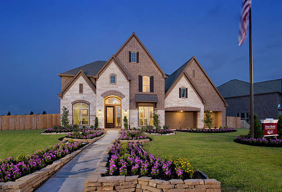 Perry Homes is debuting its new model (shown) in Cypress Creek Lakes' new 80-foot homesite section. Photo: BRUCE GLASS