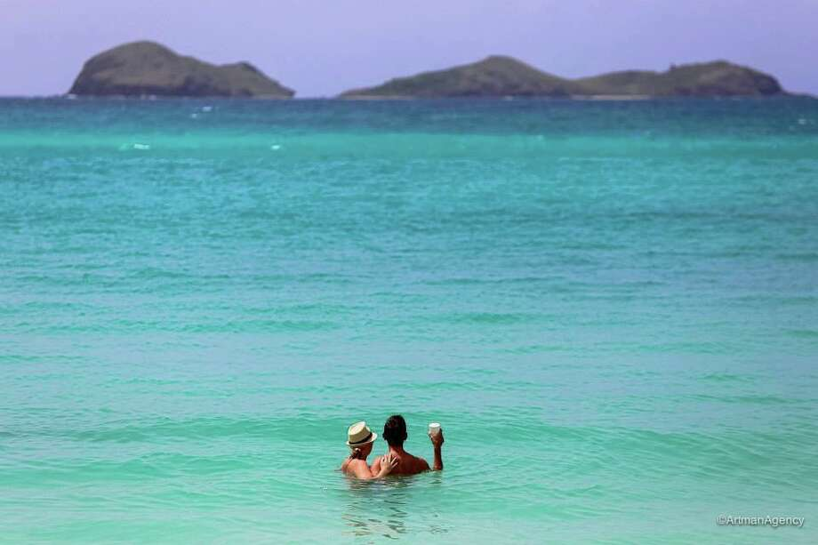 Over summer 2013, we asked Chronicle readers to send us their vacation photos. Keep clicking for ideas to think about while planning your next trip. This photo: A photographer snapped this picture of us while we were on our honeymoon in St. Barth's in June 2013.  We were swimming at St. Jean beach and this was taken right after we saw a baby sting ray!