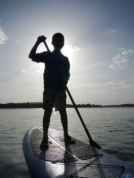 Inks Lake State Park, Burnet, TX  Camping with great friends, lots of time in the water...it was HOT.  This photo is of my 9 year old son Gavin, his first time Stand Up Paddle Boarding.  He was a natural...didn't fall once...unlike his Dad :0)