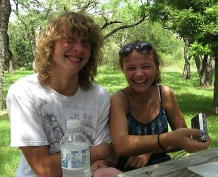 This photo was taken at Enchanted Rock in Freidricksburg, TX. My son and daughter were joking around at lunch time. This was taken in the summer of 2010 and the last vacation to have with all 4 of us.