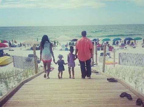 This family photo was taken on the sandy white beaches of Destin Florida, during our 2013 summer vacation.