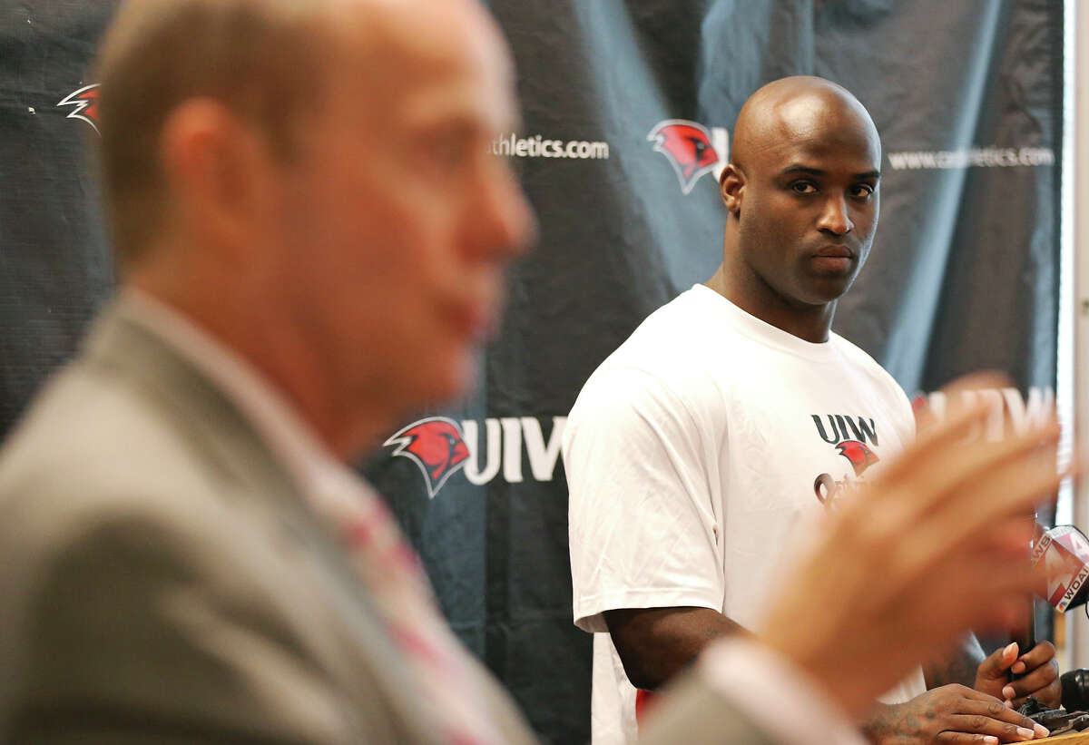 University of the Incarnate Word head football coach Larry Kennan (left) speaks as new assistant coach Ricky Williams looks on during a press conference held Thursday Aug. 15, 2013 at the university.