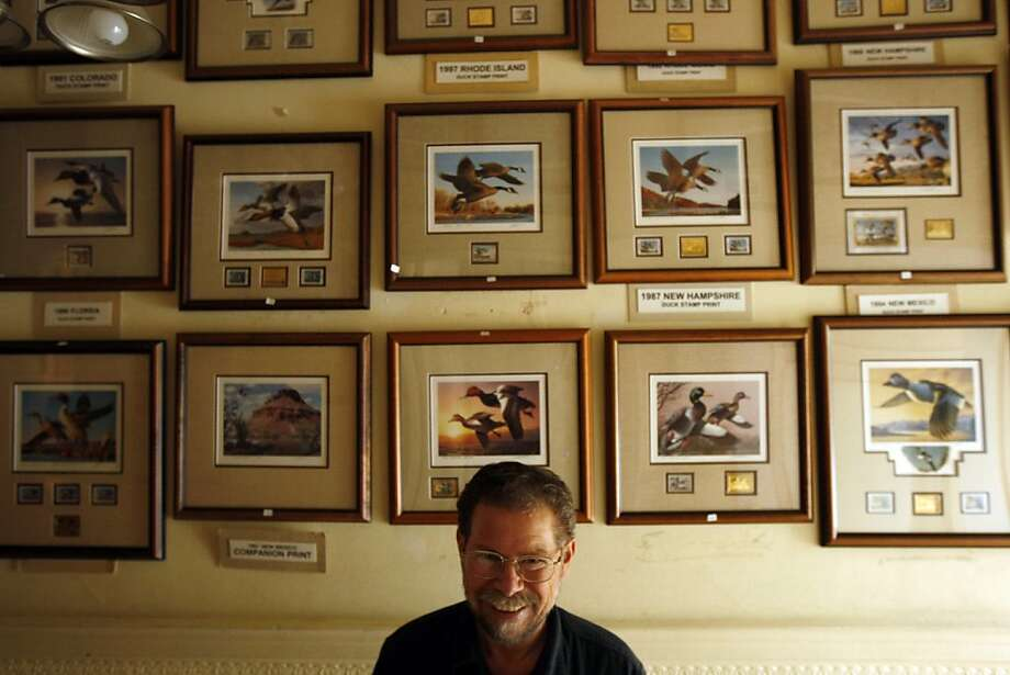 Richmond District painter Bob Steiner shows some prints of the paintings that have won state competitions over the years. Photo: Rohan Smith, The Chronicle