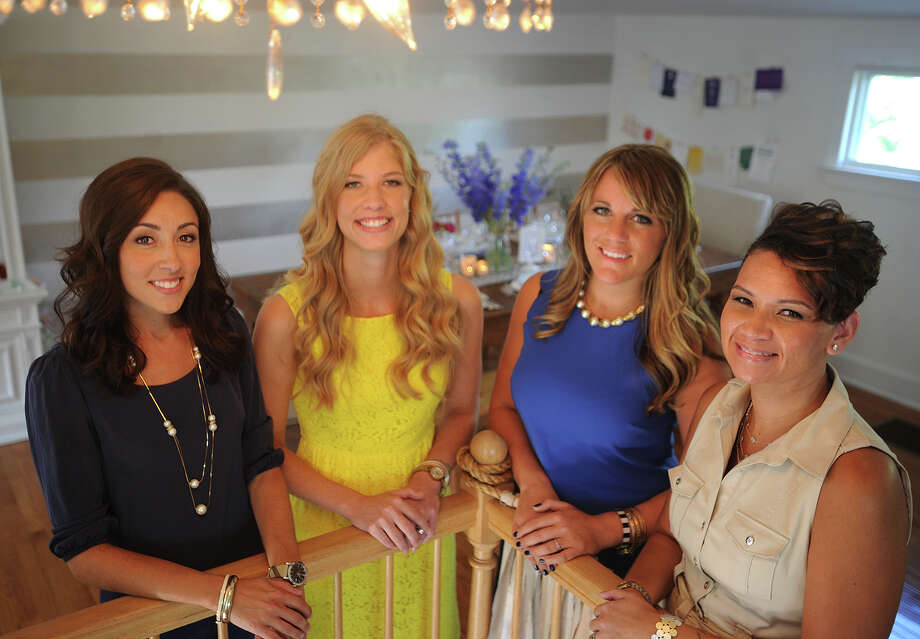From left; Brooke Sforza, of Brooke Allison Photo, Sandy Shannon, of Roseville Designs, Amy Cagginello, of Amy Champagne Events, and Donna Ramos-Casiano, of Little Random Details, share space for client consultations at The Wedding Loft of Connecticut, at 18 Daniel Street in downtown Milford. Photo: Brian A. Pounds / Connecticut Post