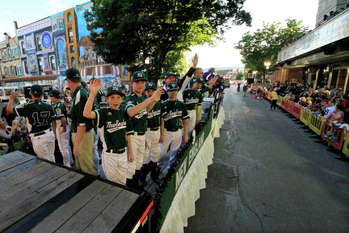 Members of the Little League team from Westport, Conn., ride in the Little League Grand Slam Parade as it makes its way through downtown Williamsport, Pa., Wednesday, Aug. 14, 2013. The Little League World Series tournament begins Thursday, August 15, in South Williamsport, Pa.