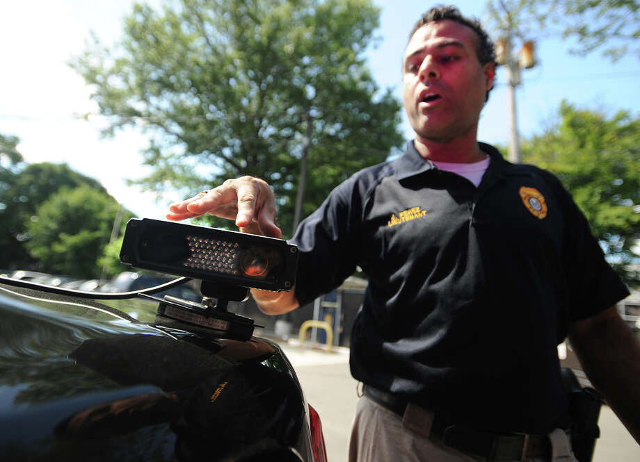 Fairfield police Lt. James Perez discusses the department's new car-mounted license plate reading system in Fairfield, Conn. on Thursday, August 15, 2013. Photo: Brian A. Pounds / Connecticut Post