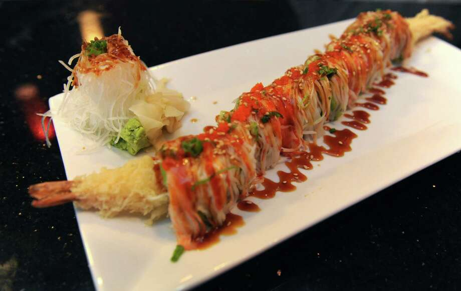 The New York Giant roll at the Tea House Asian Bistro on Friday Aug. 19, 2013 in Delmar, N.Y. (Michael P. Farrell/Times Union) Photo: Michael P. Farrell / 00023466A
