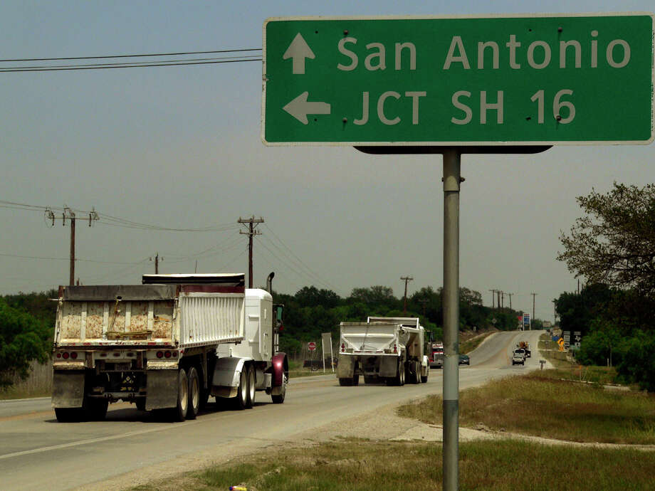 The Legislature's decision to ask voters to approve using part of the rainy day fund for transportation is a decent first step, but it doesn't solve the state's long-term problem. Photo: Billy Calzada, San Antonio Express-News / gcalzada@express-news.net