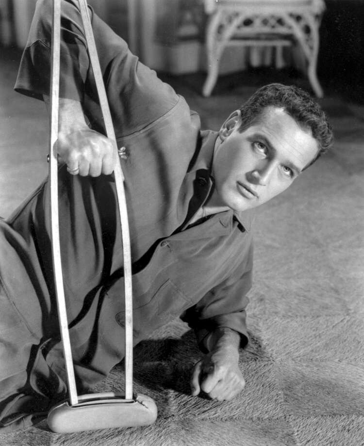 "In this 1959 file photo originally released by MGM pictures, actor Paul Newman appears as the character Brick Pollitt in the film version of Tennessee William's Pulitzer Prize-winning play ''Cat on a Hot Tin Roof.'' Newman, the Academy-Award winning superstar who personified cool as an activist, race car driver, popcorn impresario and the anti-hero of such films as ""Hud,"" ""Cool Hand Luke"" and ""The Color of Money,"" has died, a spokeswoman said Saturday. He was 83. Newman died Friday, Sept. 26, 2008, of cancer, spokeswoman Marni Tomljanovic said. (AP Photo/MGM) ** NO SALES ** Photo: AP / MGM"
