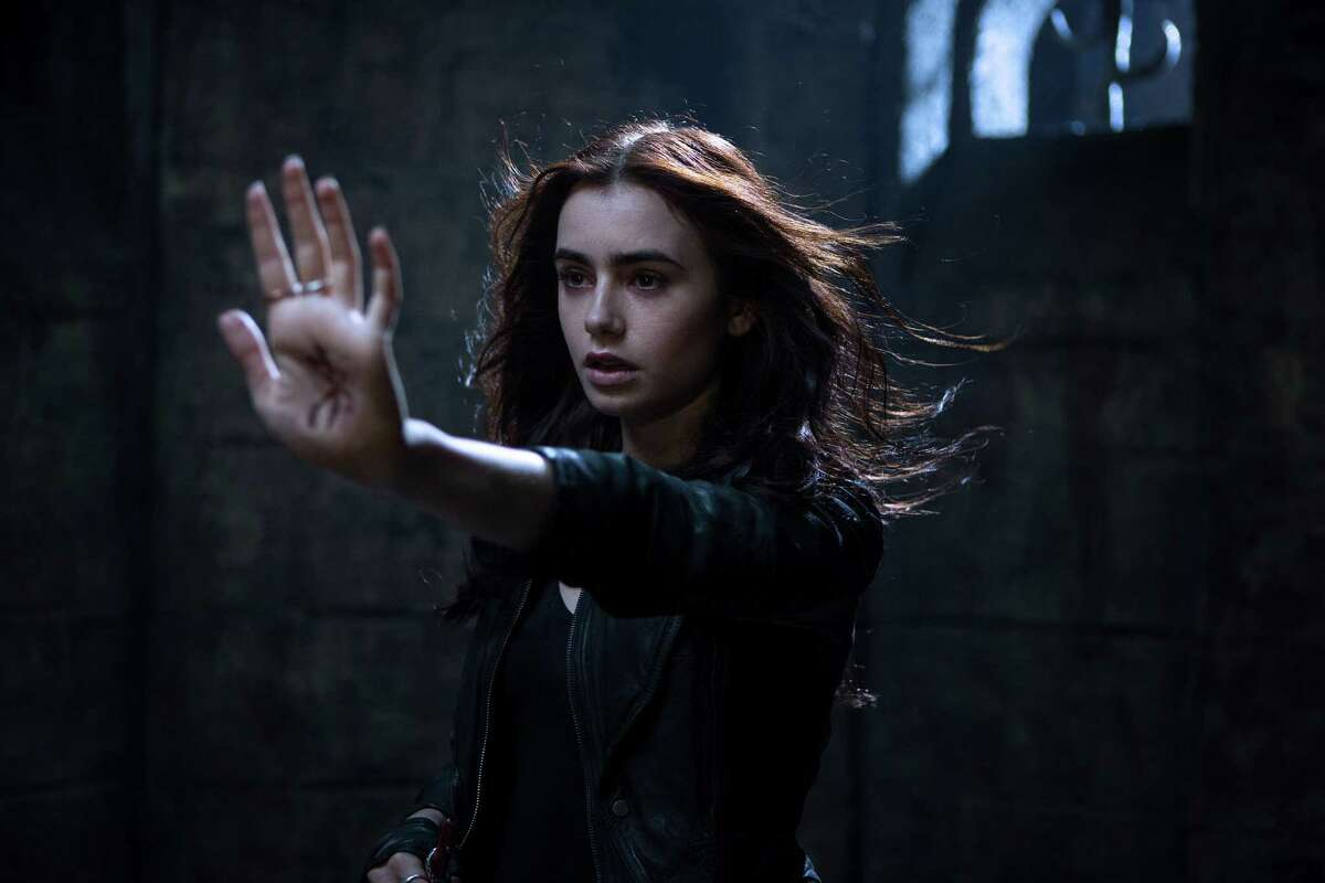Coming attractions: Opening Wednesday, 'City of Bones' will be followed by these YA titles: Clary Fray (Lily Collins) in 'Mortal Instruments: City of Bones'