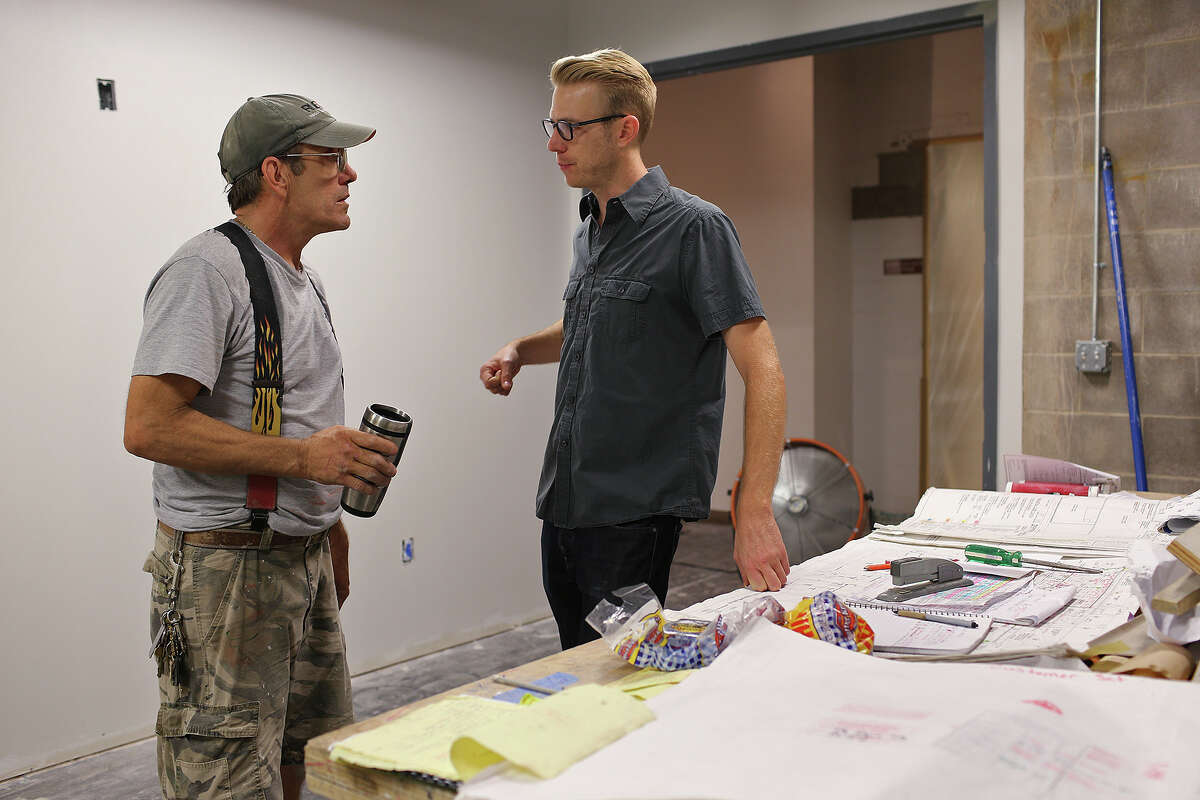 Justin Boyd, chair of the Southwest School of Art Sculpture and Integrated Media Department, right, talks with project manager Johnny Sosenk with Rubiola Construction Company, at the school's Navarro Campus, Thursday, Aug. 8, 2013.