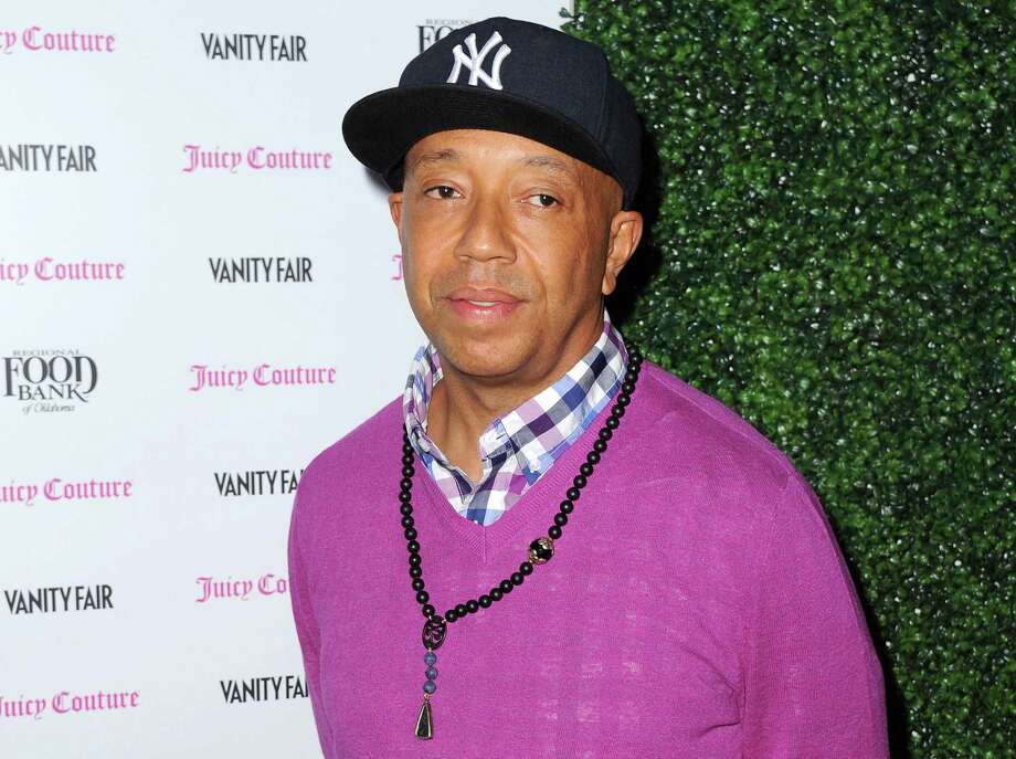 FILE - In this Feb. 18, 2013 file photo, Russell Simmons arrives at the Vanity Fair and Juicy Couture Celebration for the 2013 Vanities Calendar in Los Angeles. Simmons is apologizing for a parody video of Harriet Tubman in a sex tape that appeared on his All Def Digital YouTube channel.  (Photo by Jordan Strauss/Invision/AP, File) Photo: AP