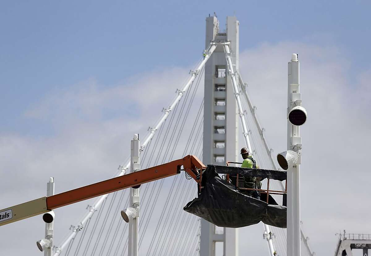 This photo taken Thursday, Aug. 1, 2013 shows a worker on the new eastern section of the San Francisco-Oakland Bay Bridge in San Francisco. The opening day for the trouble- and delay-plagued eastern span of the San Francisco-Oakland Bay Bridge is scheduled to be announced by the Toll Bridge Oversight Committee on Thursday, Aug. 15, 2013. (AP Photo/Eric Risberg)