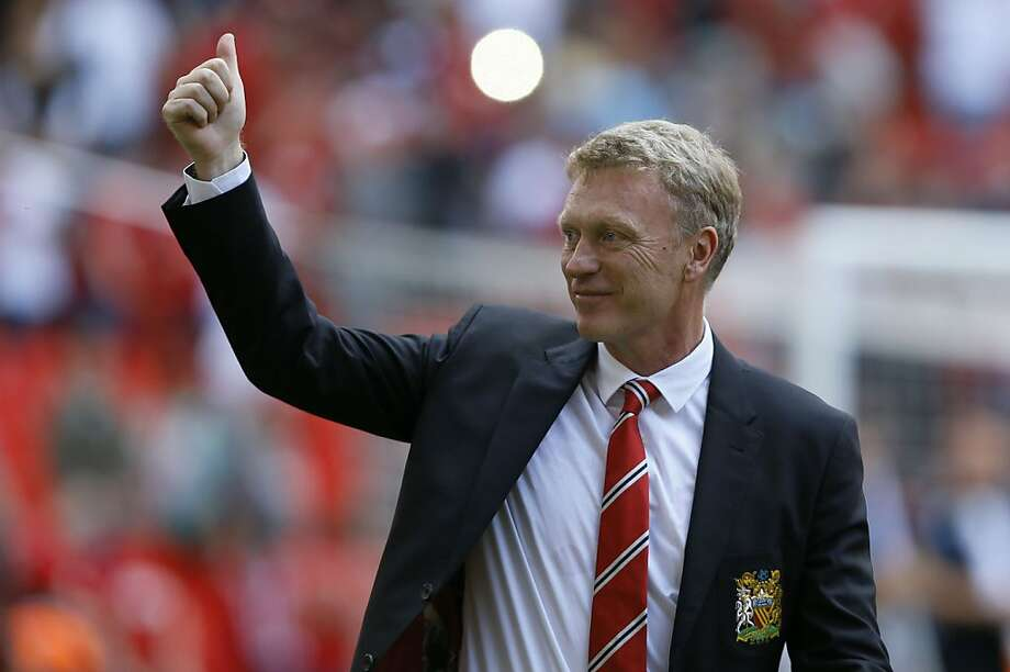 Manchester United manager David Moyes is pleased with his team's victory over Wigan Athletic on Sunday in London. Photo: Kirsty Wigglesworth, Associated Press