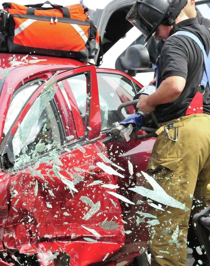Glass shattered as a door was removed to free the driver after a two-vehicle accident Thursday afternoon in Lumberton sent one to the hospital. Photo: Cassie Smith