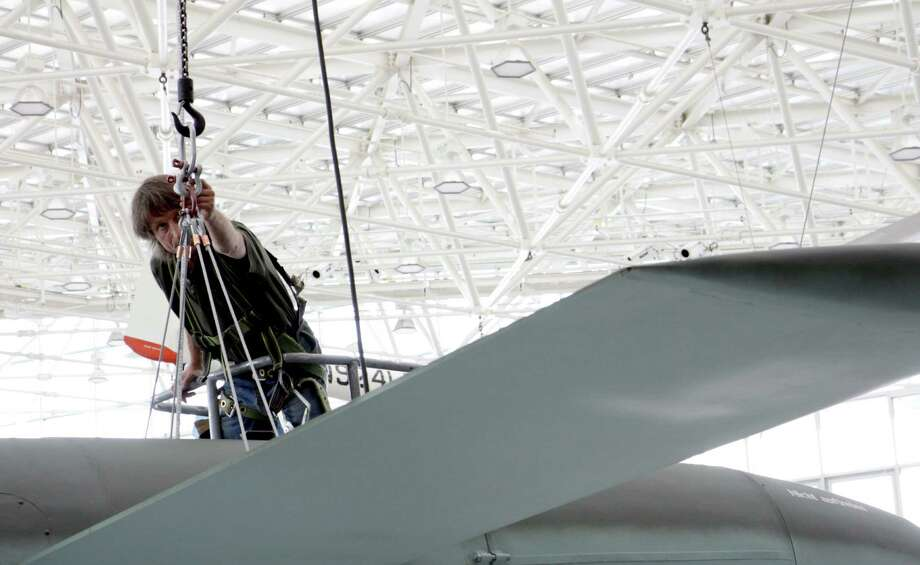 Rigger Maynard Smith adjusts the turnbuckle holding the Museum of Flight's V-1 in its new home in the museum's Great Gallery on Wednesday, Aug. 14, 2013. Photo: Ted Huetter / The Museum of Flight, Seattle