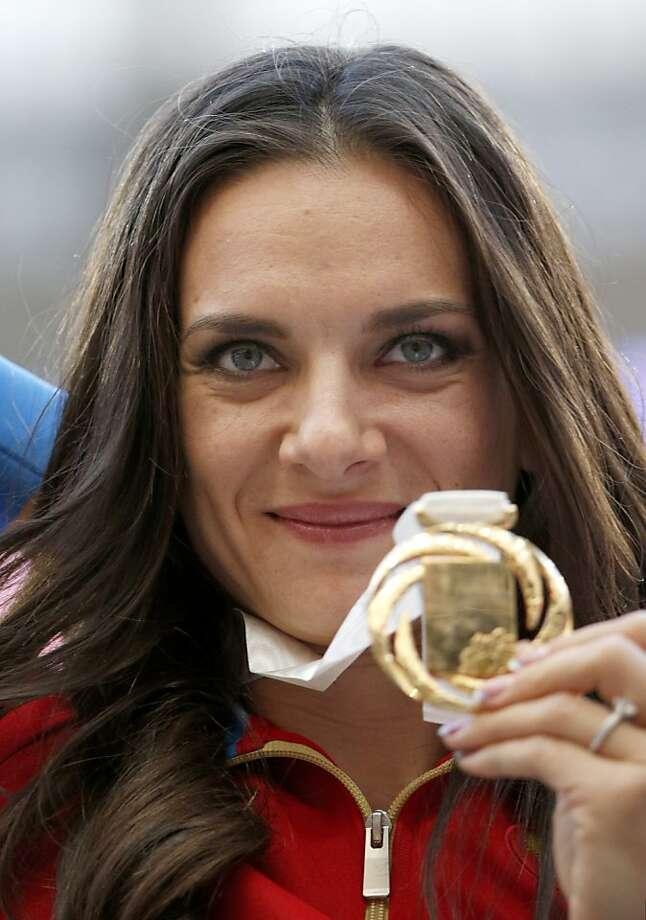 Yelena Isinbayeva won a gold medal in the women's pole vault. Photo: Alexander Zemlianichenko, Associated Press