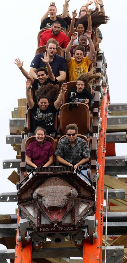 Visitors ride the new Iron Rattler at Six Flags Fiesta Texas. Photo: John Davenport / San Antonio Express-News