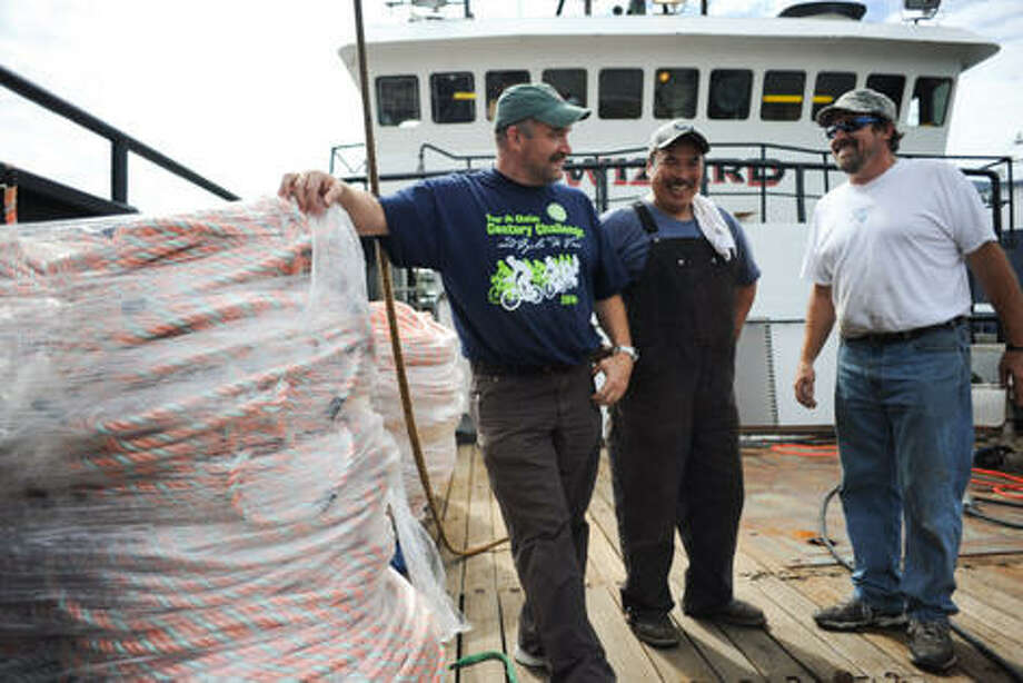 The Discovery Channel's Deadliest Catch show featured some Seattle-area crews, including the one on board The Wizard. From left to right: Captain Keith Colburn, Engineer Lenny Lekanoff, and First Mate Monte Colburn stand on the deck of the Wizard. Photo: Elliot Suhr/Seattlepi.com, ELLIOT SUHR