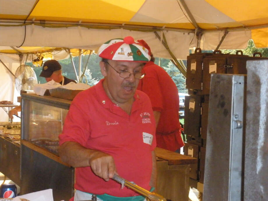 "Donald Gallant, known as ""Donnie G,"" has become one of the storied pizza frita makers at the annual St. Jude Italian festival, which runs this weekend in Monroe. Photo: Contributed Photo"