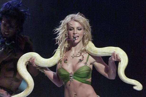 (FILES): This 06 September 2001 file photo shows US pop star Britney Spears performing with a snake draped over her shoulders at the 2001 MTV Video Music Awards in New York City.  Spears suffered a fresh legal setback 21 September 2007 after being charged with involvement in a hit-and-run incident following a minor parking lot scrape, Los Angeles prosecutors said. The troubled pop princess, who was this week ordered to undergo random drug and alcohol testing as part of her custody battle with ex-husband Kevin Federline, faces an arraignment hearing on October 10, city attorneys said. Spears, 25, has also been charged with driving without a valid California license. She will not be required to attend next month's court hearing because the allegations are only misdemeanor counts. The charges stem from an incident in a private parking lot 06 August 2007, where she was captured on film by paparazzi journalists bumping another vehicle before driving off. No-one was hurt in the incident and damage to the other vehicle appeared to be minor.   AFP PHOTO/FILES/Timothy A. CLARY