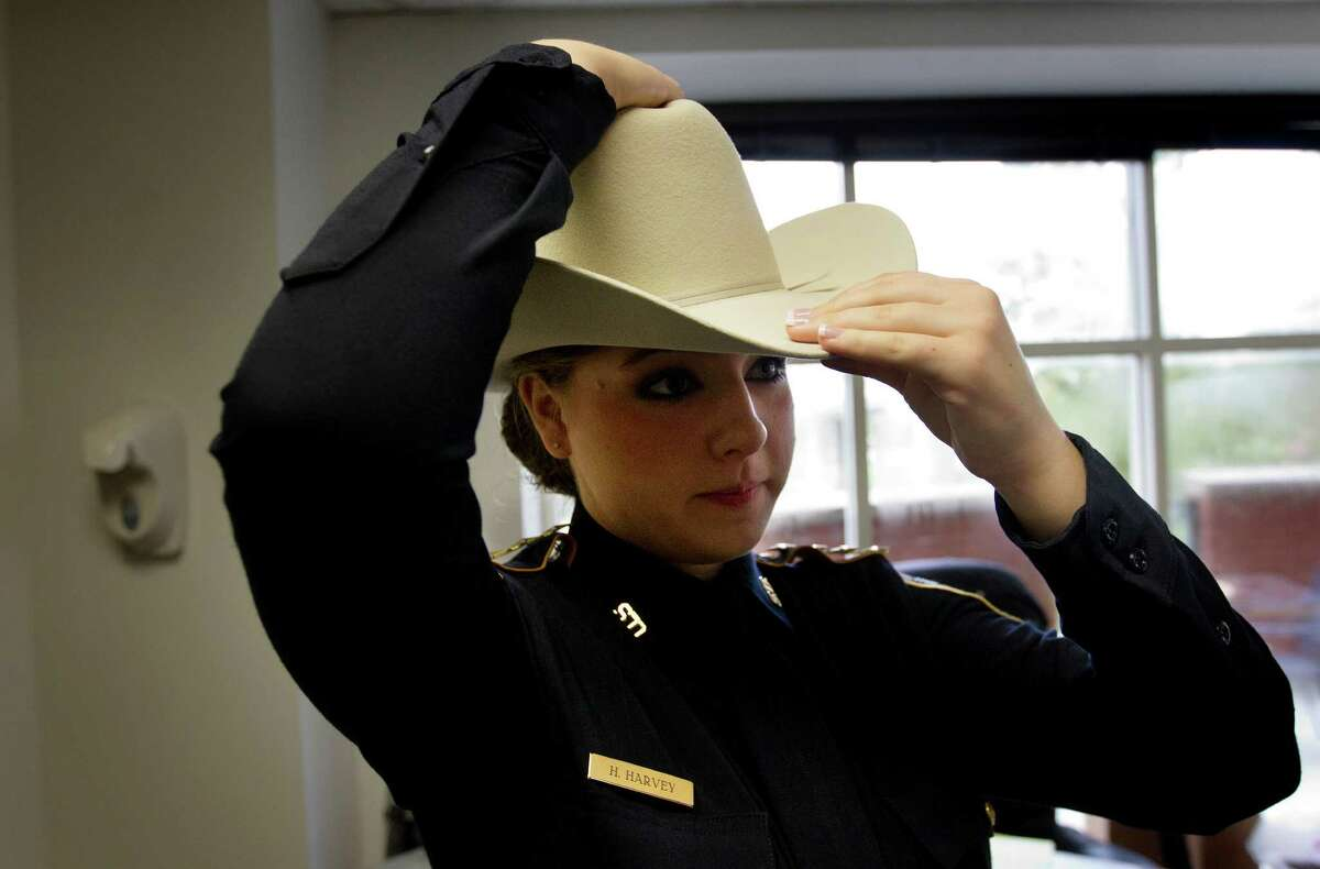 Harris County Sheriff's Office Explorer, Sergeant Haley Rose Harvey adjusts her hat before her swearing in ceremony in the 701 N. San Jacinto Street Jail's officer dining room, Thursday, Aug. 15, 2013, in Houston. The Concordia Lutheran High School junior took the oath to become the first annual Harris County