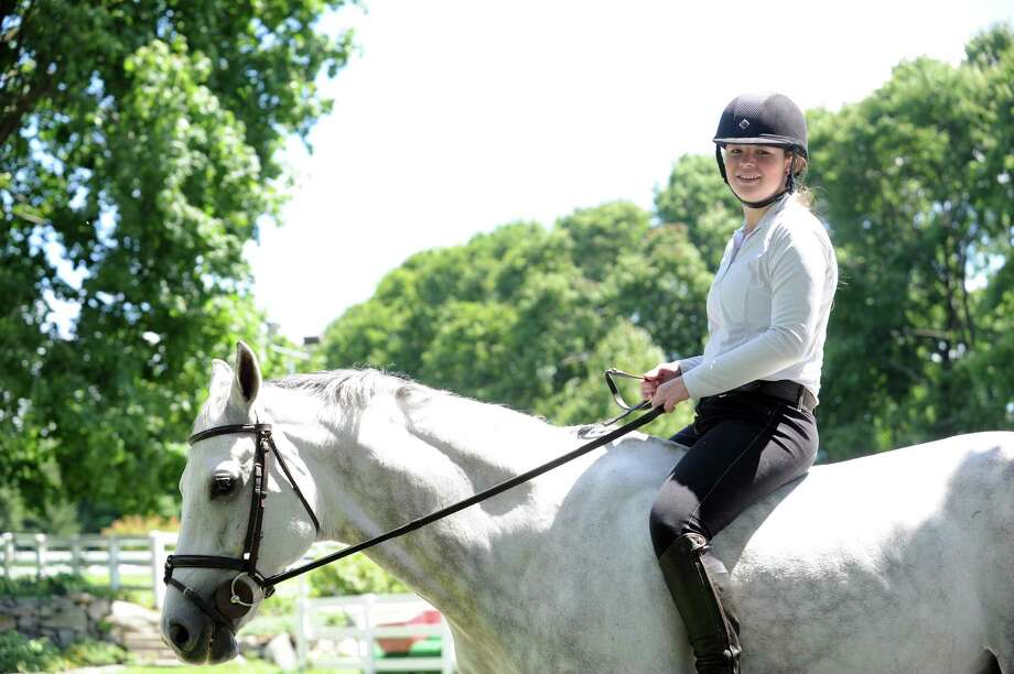 Lindsay Schauder, 13, rides a horse without a saddle, at Country Lane Farm's Round Hill Barn, in Greenwich, Conn., Wednesday, August 14, 2013. Photo: Helen Neafsey / Greenwich Time