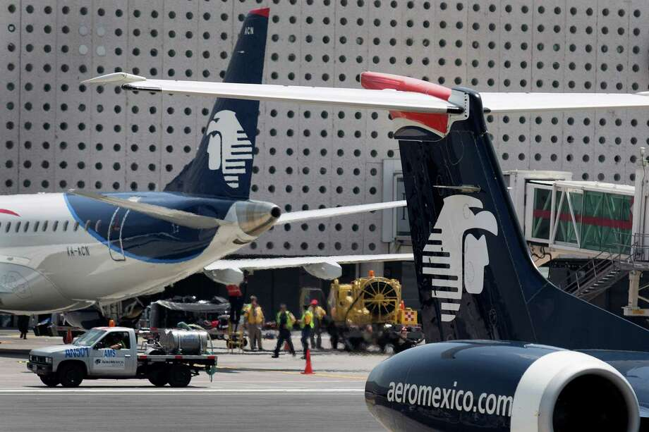 Grupo Aeromexico SAB airplanes sit on the tarmac at Benito Juarez International Airport (AICM) in Mexico City, Mexico, on Monday, Aug. 5, 2013. Grupo Aeromexico SAB, Mexico's largest airline, is preparing to tap the U.S. corporate bond market to help pay for an $11 billion Boeing Co. jet order that marks the country's biggest aircraft purchase ever. Photographer: Susana Gonzalez/Bloomberg Photo: Susana Gonzalez / © 2013 Bloomberg Finance LP