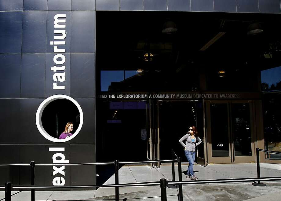 Visitors exit the Exploratorium in San Francisco, Calif., Thursday, August 15, 2013.  The Exploratorium is laying off some of its employees because of lower attendance than expected. Photo: Sarah Rice, Special To The Chronicle