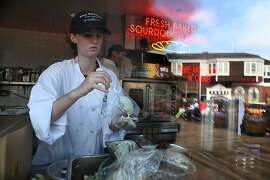 Line cook Hayley Smith preps baked oysters at Fog Harbor Fish House at Pier 39 in San Francisco, Calif.,  on Thursday, July 30, 2013.