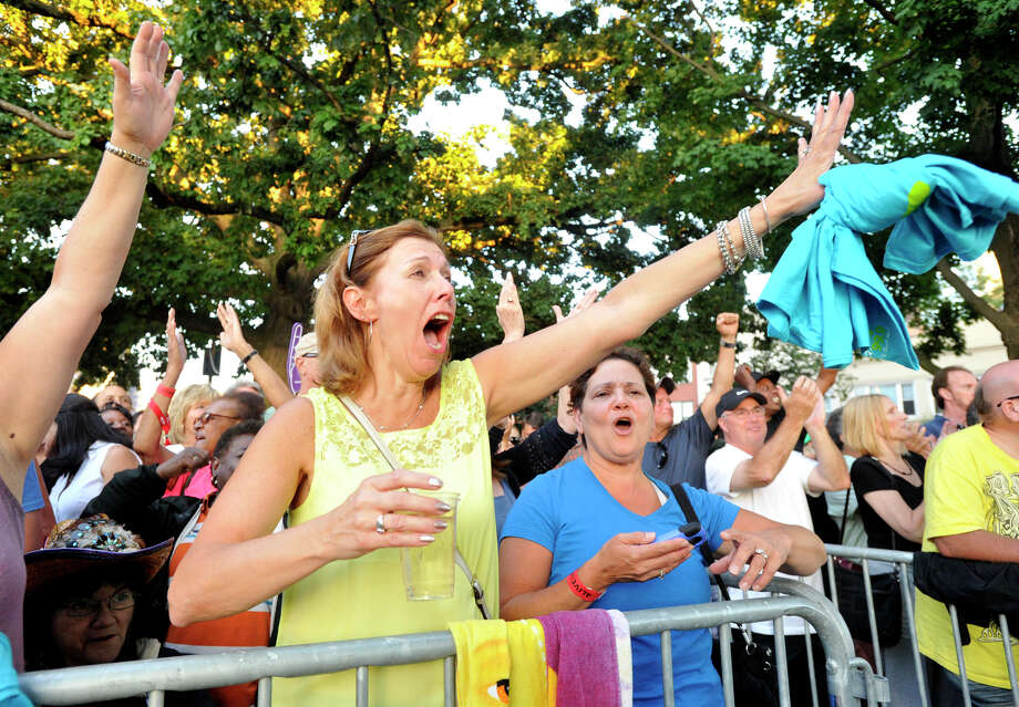Stephanie Bournazian, left, and Michele Williams cheer on Michael McDonald as he takes the stage during the Alive@Five concert series at Columbus Park in Stamford on Thursday, Aug. 15, 2013. Hearst Connecticut Newspapers are one of the sponsors of the event. Photo: Jason Rearick / Stamford Advocate