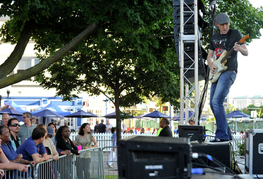 Kevin Cunningham plays guitar for the band Stolen Rhodes during the Alive@Five concert series at Columbus Park in Stamford on Thursday, Aug. 15, 2013. Hearst Connecticut Newspapers are one of the sponsors of the event. Photo: Jason Rearick / Stamford Advocate