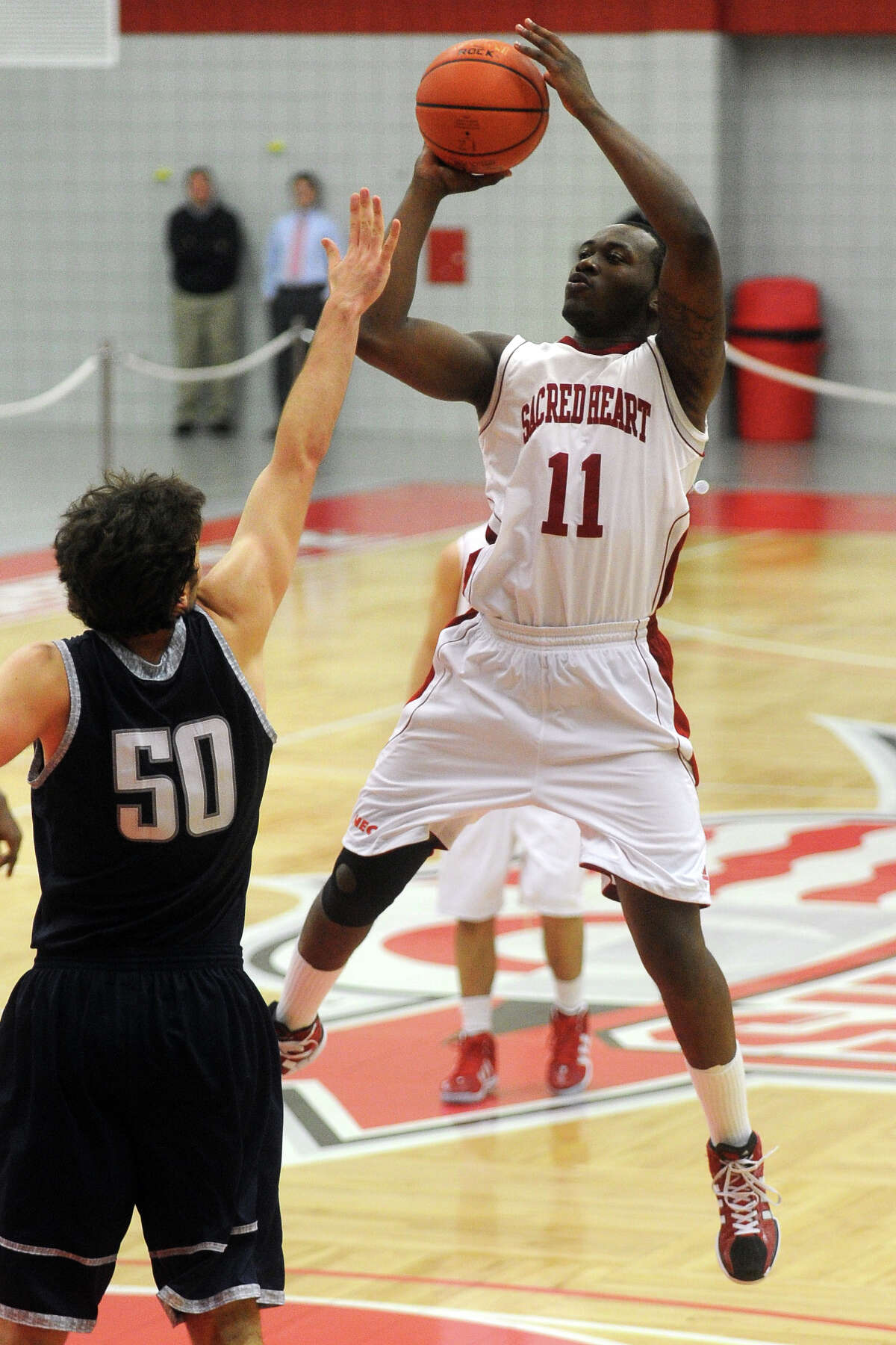 Sacred Heart's Chris Evans shoots over Yale's Jeremiah Kreisberg during basketball action at Sacred Heart University, in Fairfield, Conn. Dec. 5th, 2011. Yale defeated SHU 73-71.