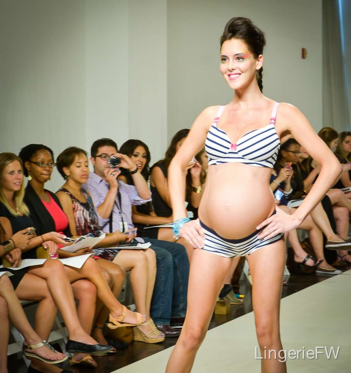 A model walks the runway in You! Lingerie, a new maternity line by Uyo Okebie-Eichelberger, which debuted at the first Lingerie Fashion Week in New York in August.