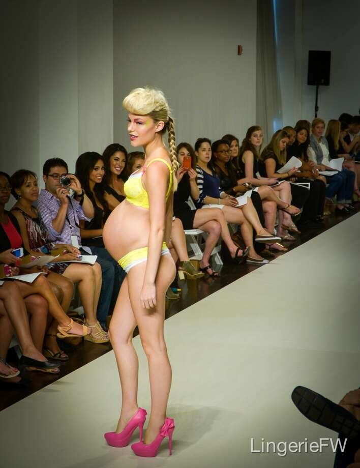 A model walks the runway in You! Lingerie, a new maternity line by Uyo Okebie-Eichelberger, which debuted at the first Lingerie Fashion Week in New York in August. Photo: Alberto Lama, Alberto Lama Photography