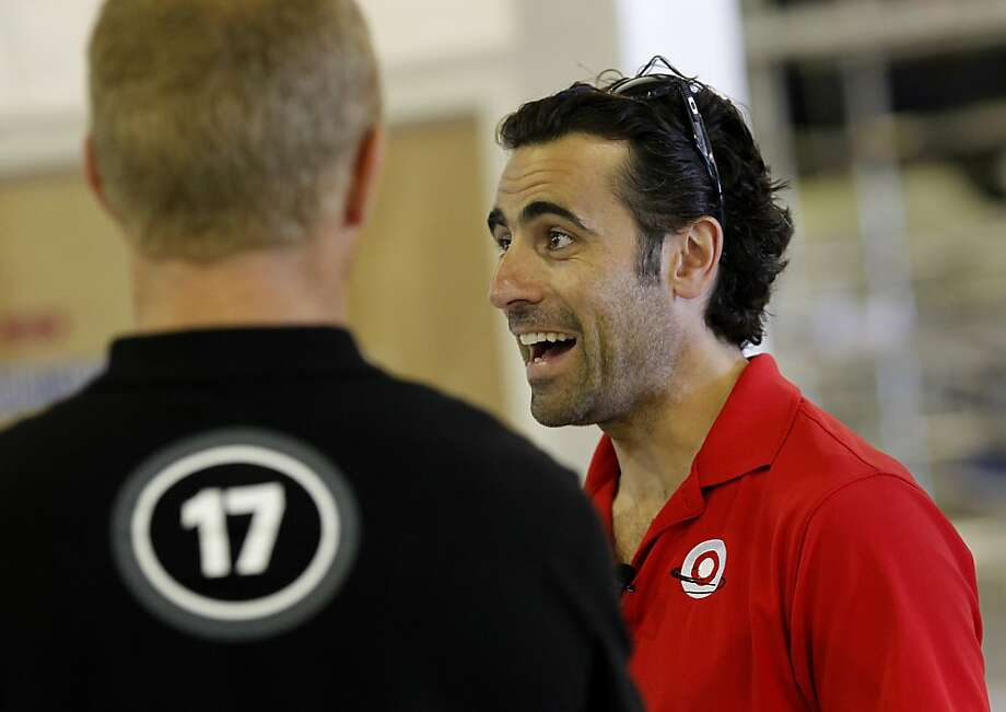 IndyCar champion Dario Franchitti (right) enjoyed a light moment in his tour with skipper Jimmy Spithill Thursday August 15, 2013. Three time IndyCar champion Dario Franchitti received a tour of the Oracle Team USA headquarters in San Francisco, Calif. Photo: Brant Ward, The Chronicle