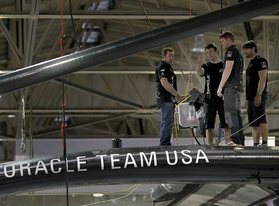Members of the Oracle crew watch as skipper Jimmy Spithill showed IndyCar champ Dario Franchitti the big boats Thursday August 15, 2013. Three time IndyCar champion Dario Franchitti received a tour of the Oracle Team USA headquarters in San Francisco, Calif. Photo: Brant Ward, The Chronicle