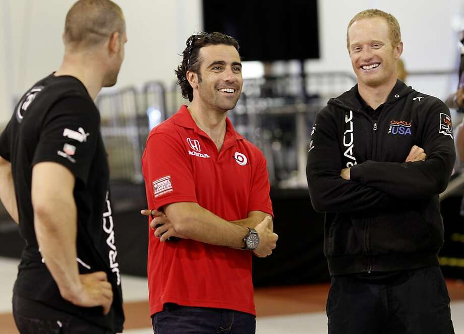 IndyCar champion Dario Franchitti (center) enjoyed a moment with skipper Jimmy Spithill (right) Thursday August 15, 2013. Three time IndyCar champion Dario Franchitti received a tour of the Oracle Team USA headquarters in San Francisco, Calif. Photo: Brant Ward, The Chronicle
