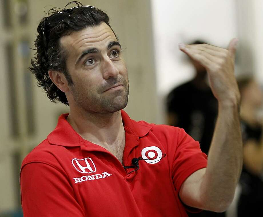 IndyCar champion Dario Franchitti makes a point as he talks with skipper Jimmy Spithill during his tour Thursday August 15, 2013. Three time IndyCar champion Dario Franchitti received a tour of the Oracle Team USA headquarters in San Francisco, Calif. Photo: Brant Ward, The Chronicle