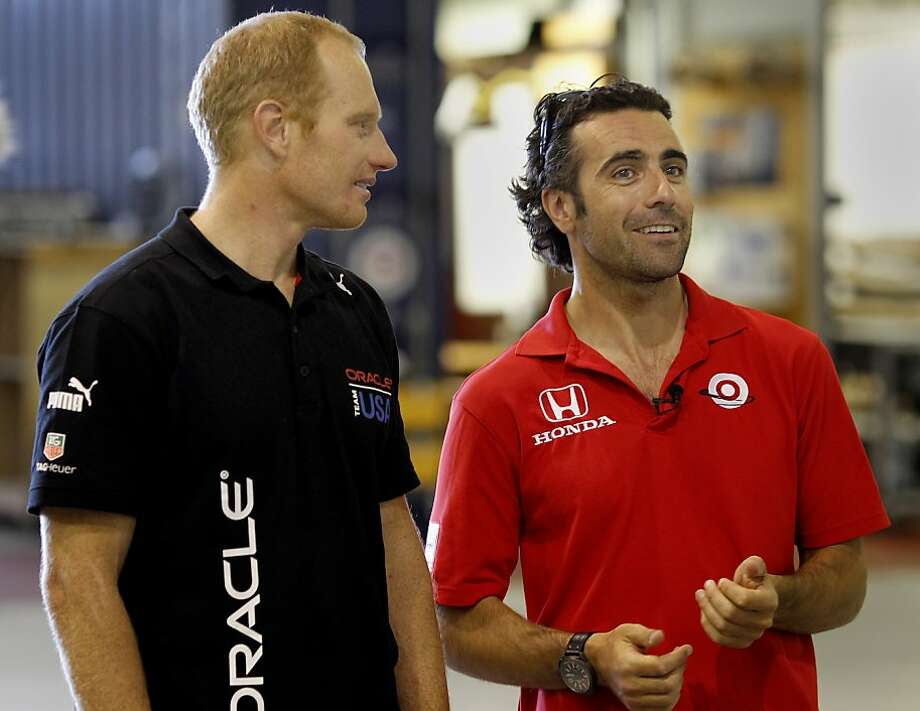 Race car drive Dario Franchitti (right) got a tour of the Oracle facilities by skipper Jimmy Spithill Thursday August 15, 2013. Three time IndyCar champion Dario Franchitti received a tour of the Oracle Team USA headquarters in San Francisco, Calif. Photo: Brant Ward, The Chronicle