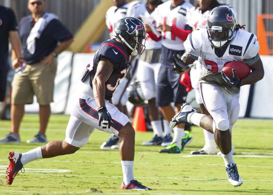 As a converted running back, new Texans fullback Greg Jones, right, also can be a load to handle with the ball in tow, as safety Eddie Pleasant discovered. Photo: Brett Coomer, Staff / © 2013 Houston Chronicle