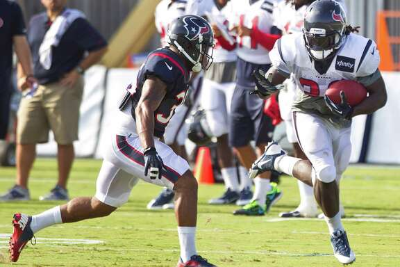 As a converted running back, new Texans fullback Greg Jones, right, also can be a load to handle with the ball in tow, as safety Eddie Pleasant discovered.