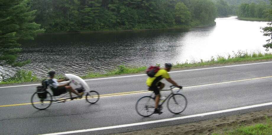 Photo by Herb Terns. Riders pass near Stony Creek on their way home from North Creek in 2010. Photo: Picasa