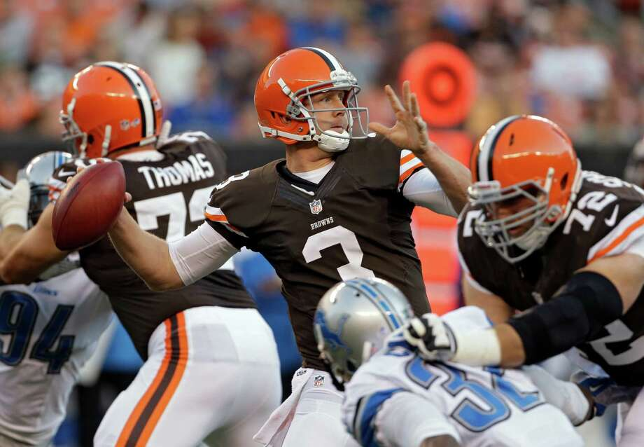 Cleveland Browns quarterback Brandon Weeden throws from the crowd during the first quarter of a preseason NFL football game against the Detroit Lions, Thursday, Aug. 15, 2013, in Cleveland. (AP Photo/Mark Duncan) ORG XMIT: CDS103 Photo: Mark Duncan / AP