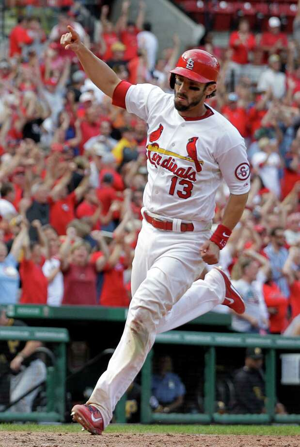 St. Louis Cardinals' Matt Carpenter celebrates as he heads home to score the game-winning run during the 12th inning of a baseball game against the Pittsburgh Pirates, Thursday, Aug. 15, 2013, in St. Louis. The Cardinals won 6-5. (AP Photo/Jeff Roberson) ORG XMIT: MOJR120 Photo: Jeff Roberson / AP