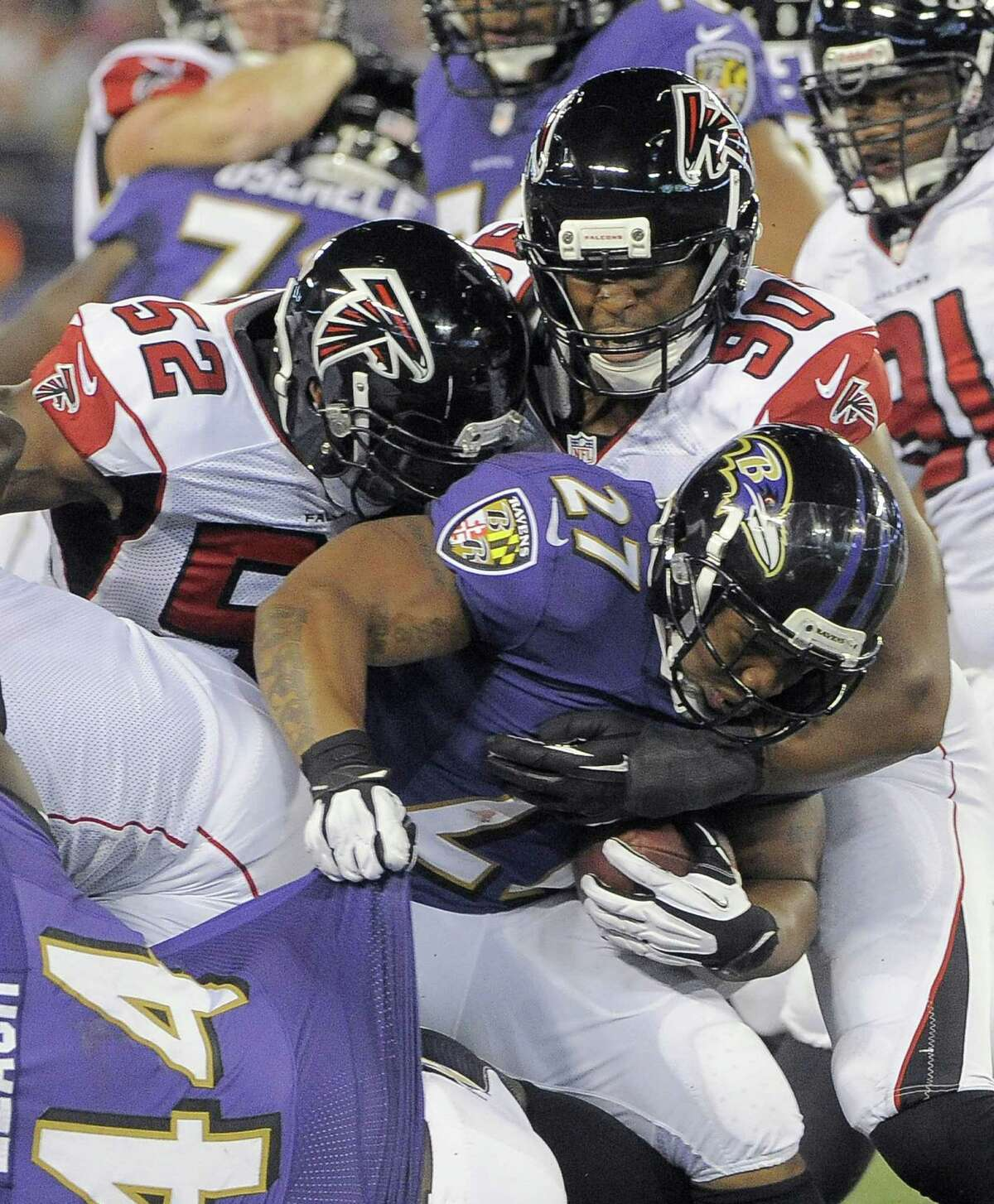 Falcons middle linebacker Akeem Dent (52) and defensive end Osi Umenyiora stop Ravens running back Ray Rice for a loss in the second quarter. Baltimore rallied for a 27-23 win.